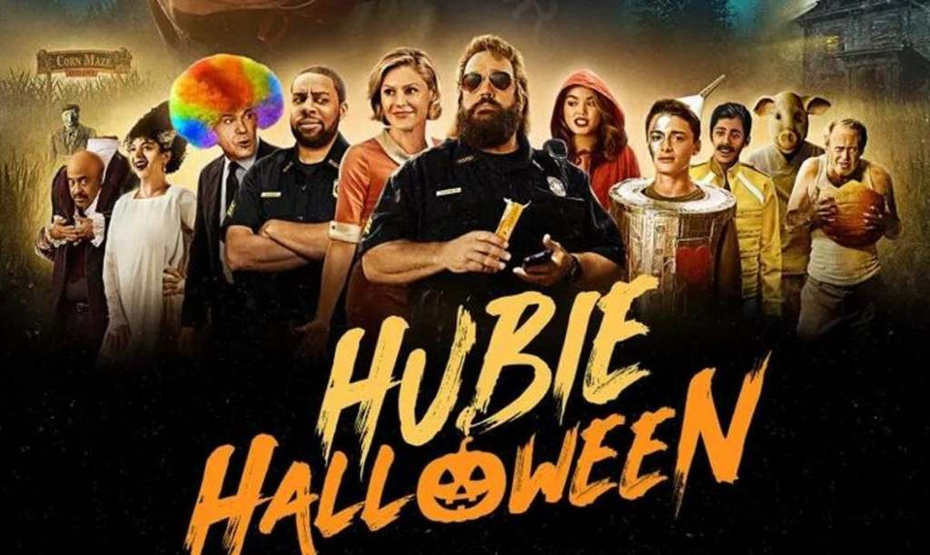 A promo image for the Hubie Halloween film. Actors pictured, from left to right: Tim Meadows, Maya Rudolph, Ray Liotta, Kenan Thompson, Julie Bowen, Kevin James, Paris Berelc, Noah Schnapp, Karan Brar, Rob Schneider, and Steve Buscemi)